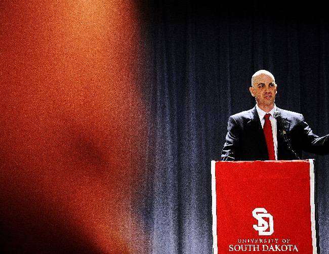 Former Nebraska assistant coach, Craig Smith, speaks during a news conference announcing Smith as the new South Dakota NCAA college basketball coach on Monday, March 24, 2014, in Vermillion, S.D