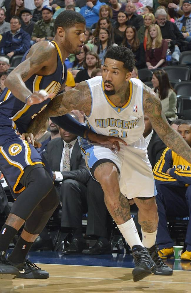 Denver Nuggets small forward Wilson Chandler (21) moves around Indiana Pacers small forward Paul George (24) during the first quarter of an NBA basketball game Saturday, Jan. 25, 2014, in Denver