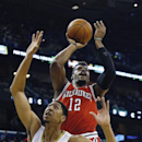 Milwaukee Bucks forward Jeff Adrien (12) shoots over New Orleans Pelicans forward Anthony Davis (23) during the first half of an NBA basketball game in New Orleans, Friday, March 7, 2014 The Associated Press