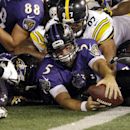 Baltimore Ravens quarterback Joe Flacco (5) is just short of a touchdown as he is hit by Pittsburgh Steelers defensive end Cameron Heyward (97) and other defenders during the second half of an NFL football game Thursday, Sept. 11, 2014, in Baltimore. The
