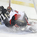 Pittsburgh Penguins' Evgeni Malkin (71) collides with Ottawa Senators goalie Craig Anderson (41) while scoring a goal during the first period of an NHL hockey game in Pittsburgh Saturday, Dec. 6, 2014 The Associated Press