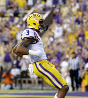 LSU wide receiver Odell Beckham celebrates his touchdown in the first half of an NCAA college football game against UAB in Baton Rouge, La., Saturday, Sept. 7, 2013. (AP Photo/Gerald Herbert)