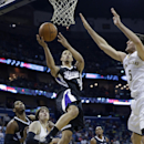 Sacramento Kings Jared Cunningham (9) goes to the basket against New Orleans Pelicans center Jeff Withey (5) and forward Luke Babbitt, second left, in the first half of an NBA basketball game in New Orleans, Monday, March 31, 2014 The Associated Press