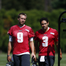 Philadelphia Eagles quarterbacks Nick Foles (9) and Mark Sanchez (3) walk off the field after NFL football practice at the team's training facility, Friday, Sept. 12, 2014, in Philadelphia The Associated Press