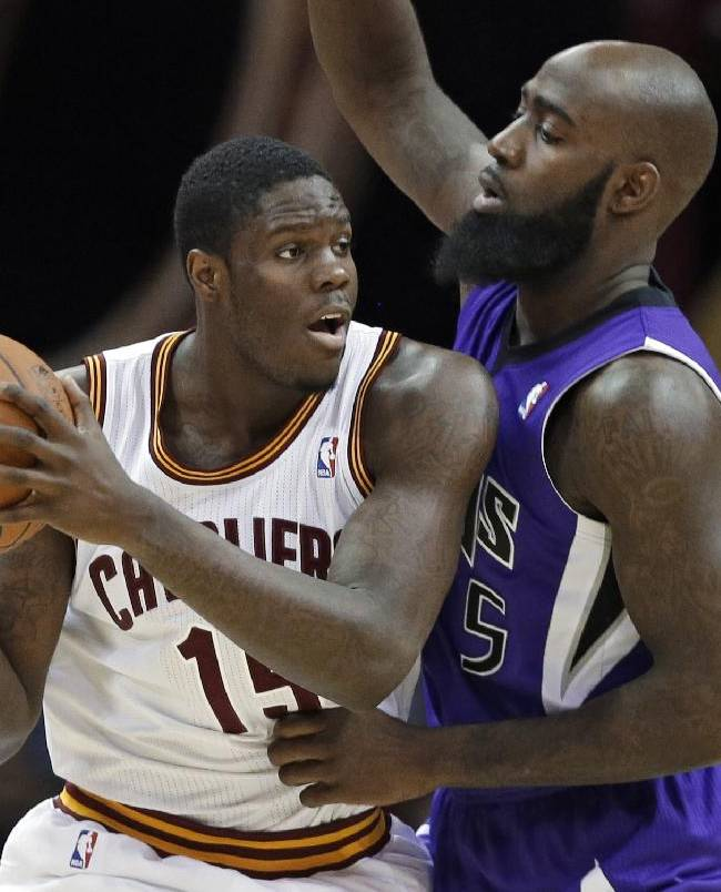Cleveland Cavaliers' Anthony Bennett, left, tries to get past Sacramento Kings' Quincy Acy during the third quarter of an NBA basketball game Tuesday, Feb. 11, 2014, in Cleveland. Bennett scored 19 points and grabbed 10 rebounds in the Cavaliers' 109-99 win