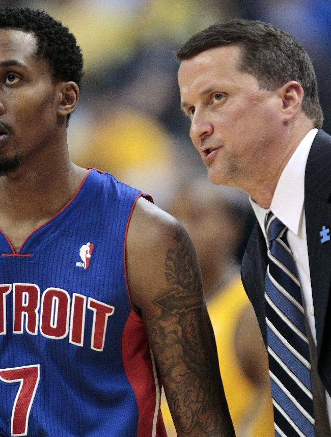 Detroit Pistons coach John Loyer, right, talks with guard Brandon Jennings during the first half of an NBA basketball game against the Indiana Pacers in Indianapolis, Wednesday, April 2, 2014. The Pacers won 101-94