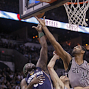 San Antonio Spurs' Tim Duncan (21) reaches for the rebound over teammate Manu Ginobili (20) and Memphis Grizzlies' Zach Randolph (50) during the first quarter of an NBA basketball game, Sunday, April 6, 2014, in San Antonio The Associated Press