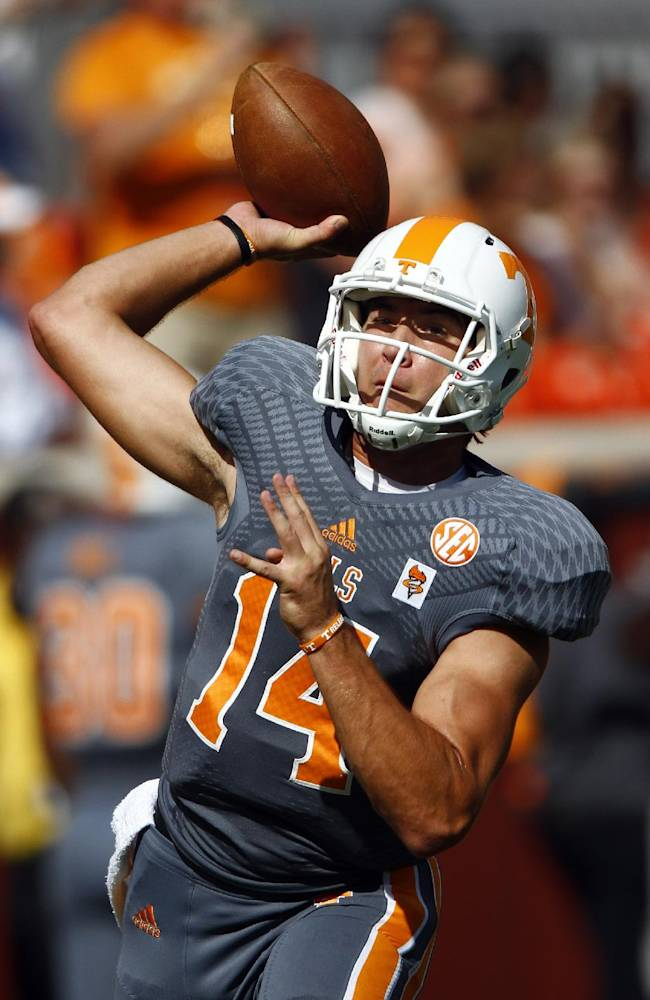 Tennessee quarterback Justin Worley (14) throws during warm-ups before an NCAA college football game against Georgia on Saturday, Oct. 5, 2013, in Knoxville, Tenn