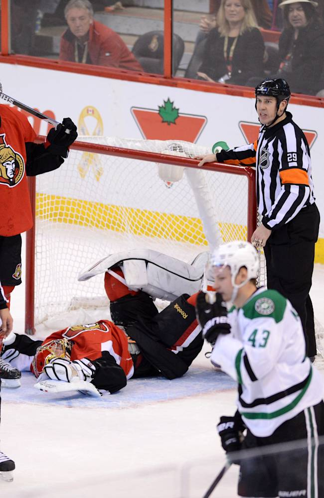 Ottawa Senators' goalie Craig Anderson lays on the ground following a collision with Dallas Stars' Valeri Nichushkin during overtime of an NHL  hockey game in Ottawa, Sunday, Nov. 3, 2013. Dallas defeated Ottawa 4-3