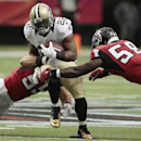 Atlanta Falcons outside linebacker Paul Worrilow, left, and Atlanta Falcons outside linebacker Joplo Bartu (59) tackle New Orleans Saints running back Mark Ingram (22) during the first half of an NFL football game, Sunday, Sept. 7, 2014, in Atlanta The As