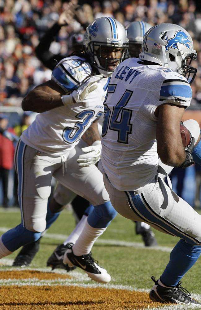 Detroit Lions linebacker DeAndre Levy (54) intercepts a pass in the end zone during the first half of an NFL football game against the Chicago Bears, Sunday, Nov. 10, 2013, in Chicago