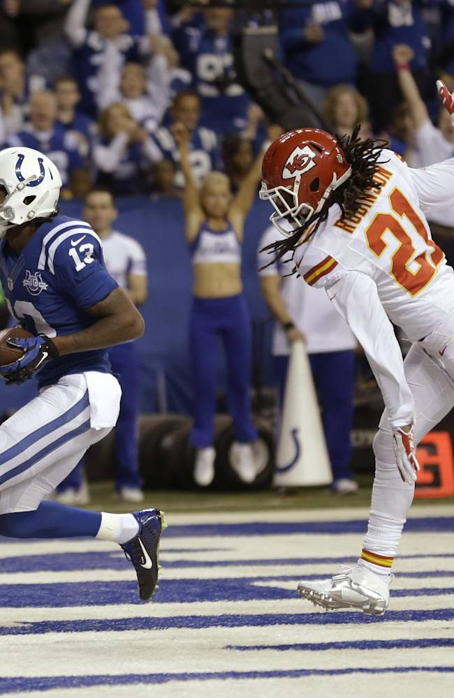 Indianapolis Colts wide receiver T.Y. Hilton (13) scores as Kansas City Chiefs cornerback Dunta Robinson (21) defends during the first half of an NFL wild-card playoff football game Saturday, Jan. 4, 2014, in Indianapolis