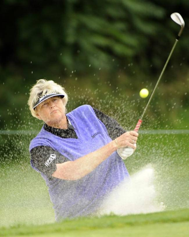 Laura Davies, of England, blasts out of a trap on the second hole during third round of the Wegmans Championship LPGA  golf tournamant Saturday, Aug. 16, 2014, in Pittsford, N.Y