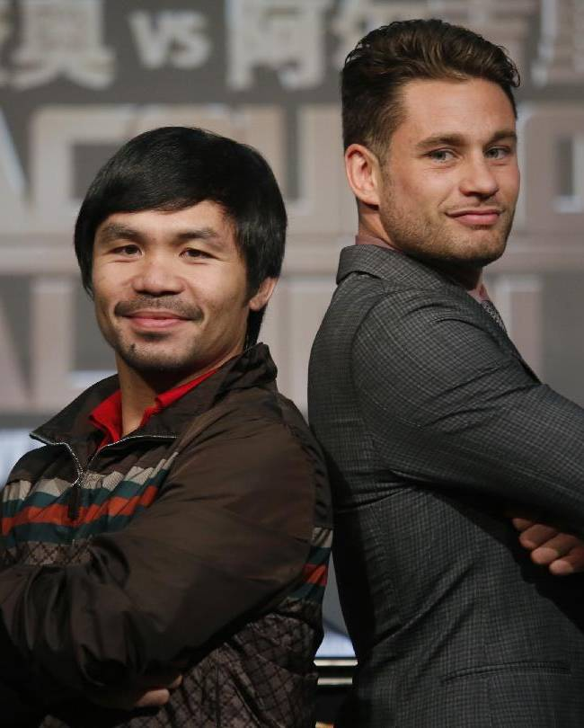 WBO Welterweight champion Manny Pacquiao, left, of the Philippines, and WBO junior welterweight champion Chris Algieri of United States, right, pose for photographers during a news conference in Macau, Monday, Aug. 25, 2014. The boxers are scheduled to battle in WBO welterweight title match at The Venetian Macao on Nov. 23 in Macau