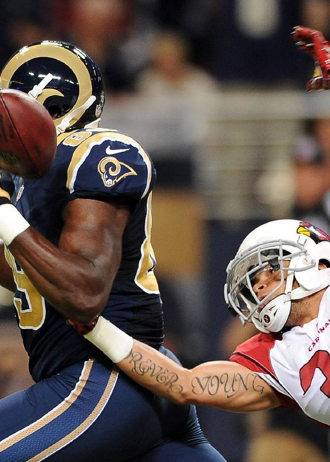 In this Sept. 8, 2013, file photo, Arizona Cardinals safety Tyrann Mathieu, right, knocks the ball out of the hands of St. Louis Rams tight end Jared Cook after Cook caught a 47-yard pass during the first quarter of an NFL football game in St. Louis. Mathieu says he wants to change the minds of those in his hometown who wrote him off as a failure when he returns to New Orleans on Sunday, Sept. 22, 2013, when the Cardinals face the Saints