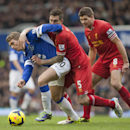 Everton s Gerard Deulofeu, left, fights for the ball against Liverpool s Daniel Agger, centre, as Steven Gerrard looks on during their English Premier League soccer match at Goodison Park Stadium, Liverpool, England, Saturday Nov. 23, 2013