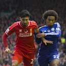 Liverpool's Emre Can fights for the ball against Chelsea's Willian during the English Premier League soccer match between Liverpool and Chelsea at Anfield Stadium, Liverpool, England, Saturday Nov. 8, 2014