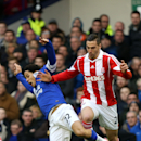 Everton s Steven Pienaar (left) and Stoke City s Geoff Cameron (right) battle for the ball during the English Premier League match at Goodison Park, Liverpool Saturday Nov. 30, 2013