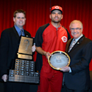 In this photo provided by the Cincinnati Reds, Reds baseball player Joey Votto, center, accepts the Tip O'Neill Award from Canadian Baseball Hall of Fame & Museum director of operations Scott Crawford, left, and chair of the Board of Directors of the Hall