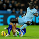 Manchester City's Bacary Sagna, right, is tackled by Leicester's Daniel Drinkwater during the English Premier League soccer match between Leicester City and Manchester City at King Power Stadium, in Leicester, England, Saturday, Dec. 13, 2014