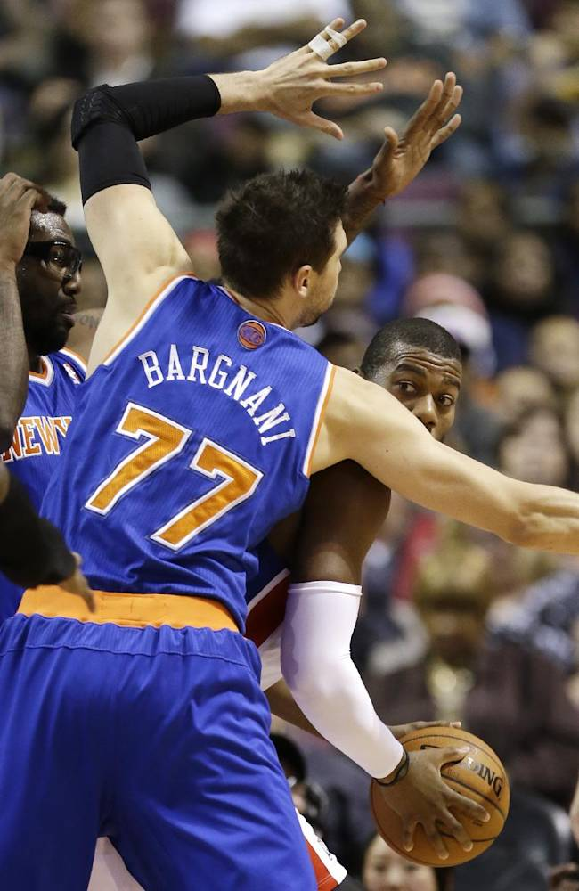 Detroit Pistons forward Greg Monroe looks to pass around New York Knicks power forward Andrea Bargnani (77) of Italy during the first half of an NBA basketball game in Auburn Hills, Mich., Tuesday, Nov. 19, 2013