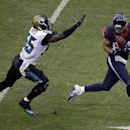 Houston Texans tight end Ryan Griffin (84) makes a reception in front of Jacksonville Jaguars outside linebacker Geno Hayes during the third quarter of an NFL football game Sunday, Nov. 24, 2013, in Houston The Associated Press