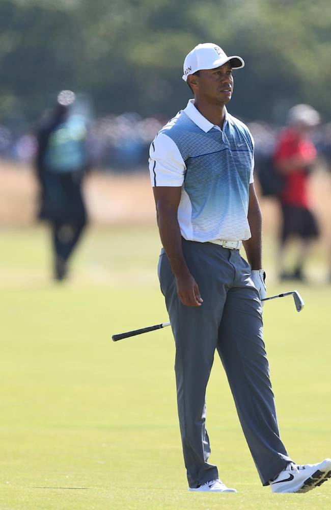 Tiger Woods of the US looks along the 4th fairway during the first day of the British Open Golf championship at the Royal Liverpool golf club, Hoylake, England, Thursday July 17, 2014