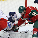 Minnesota Wild's Thomas Vanek, right, of Austria, tries to get to the puck as Columbus Blue Jackets goalie Sergei Bobrovsky, of Russsia, defends the net in the third period of an NHL hockey game, Monday, Jan. 19, 2015, in St. Paul, Minn. The Blue Jackets