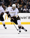 Anaheim Ducks right wing Daniel Winnik moves the puck during the third period of an NHL hockey game against the Los Angeles Kings, Saturday, April 12, 2014, in Los Angeles The Associated Press