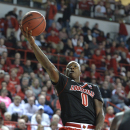 Louisville's Terry Rozier goes up for a layup during the first half of an NCAA college basketball game against Western Kentucky Saturday, Dec. 20, 2014, in Bowling Green, Ky. (AP Photo/Timothy D. Easley)