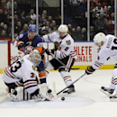 Chicago Blackhawks goalie Scott Darling (33) blocks a shot on goal by New York Islanders center Brock Nelson (29) as Blackhawks defenseman Duncan Keith (2) and center Marcus Kruger (16) defend in the second period of an NHL hockey game at Nassau Coliseum