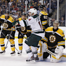 Minnesota Wild right wing Justin Fontaine (14) celebrates his goal on Boston Bruins goalie Tuukka Rask, of Finland, right, in the third period of an NHL hockey game in Boston, Tuesday, Oct. 28, 2014. The Wild won 4-3 The Associated Press