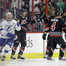 Carolina Hurricanes' Eric Staal (12) celebrates his goal with Andrej Sekera (4), of Slovakia, as Tampa Bay Lightning's Ryan Callahan (24) looks on at left during the first period of an NHL hockey game in Raleigh, N.C., Tuesday, Jan. 27, 2015. Carolina won