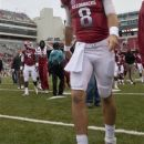 In this photo taken Sept. 15, 2012, Arkansas quarterback Tyler Wilson (8) walks from the field after Arkansas' 52-0 loss to Alabama in an NCAA college football game in Fayetteville, Ark. Wilson could not play in the game because of a head injury suffered against Louisiana-Monroe on Sept. 8, and will not play until cleared by doctors to return. (AP Photo/Danny Johnston)