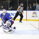 New York Rangers goalie Henrik Lundqvist (30) watches as the puck shot by Pittsburgh Penguins center Brandon Sutter enters the net during the shootout of an NHL hockey game on Wednesday, Dec. 18, 2013, in New York. The Penguins defeated the Rangers 4-3. (AP Photo/John Minchillo)