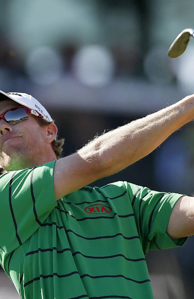 David Hearn, of Canada, watches his tee shot at the 16th hole during the third round of the Phoenix Open golf tournament Saturday, Feb. 1, 2014, in Scottsdale, Ariz