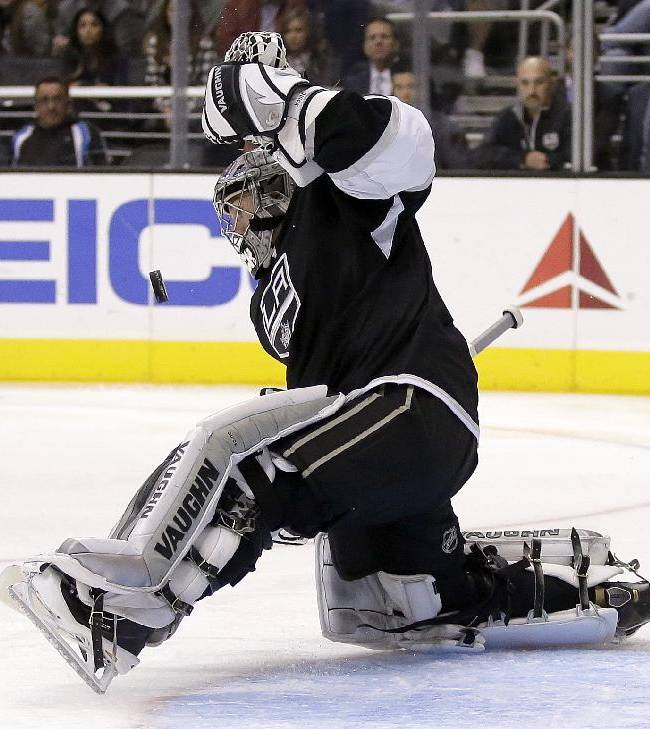 Los Angeles Kings goalie Jonathan Quick blocks a shot against the Calgary Flames during the third period of an NHL hockey game in  Los Angeles, Monday, Oct. 21, 2013. The Flames won 4-3