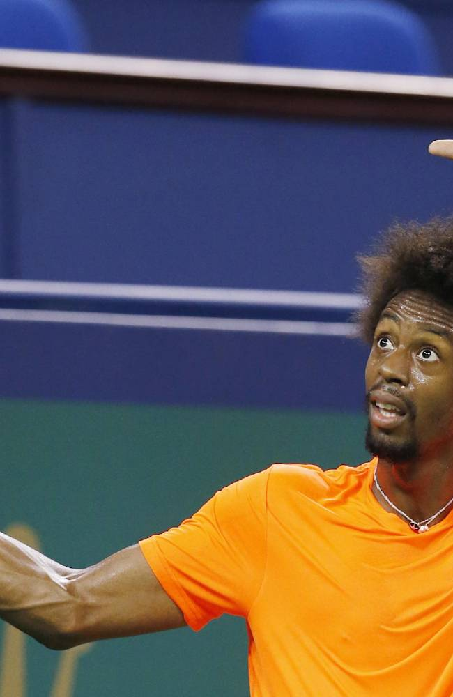 Gael Monfils of France gestures after missing a point against Japan's Tatsuma Ito at the first round of the Shanghai Masters tennis tournament at Qizhong Forest Sports City Tennis Center, in Shanghai, China, Monday, Oct. 7, 2013. Monfils won 6-3, 6-2