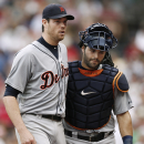 Detroit Tigers starting pitcher Doug Fister hugs catcher Alex Avila after getting out of the seventh inning with two Boston Red Sox runners on base during a baseball game at Fenway Park in Boston, Monday, Sept. 2, 2013. (AP Photo/Winslow Townson)