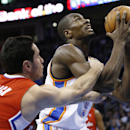 Oklahoma City Thunder forward Serge Ibaka (9) is fouled by Los Angeles Clippers guard J.J. Redick (4) while going up for a shot in the third quarter of an NBA basketball game in Oklahoma City, Thursday, Nov. 21, 2013 The Associated Press