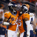 San Diego Chargers cornerback Brandon Flowers (26) celebrates his interception with teammate Chris Harris (25) during the second half of an NFL football game against the San Diego Chargers, Thursday, Oct. 23, 2014, in Denver The Associated Press