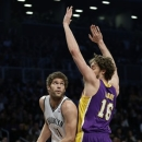 Brooklyn Nets' Brook Lopez, left, looks past Los Angeles Lakers' Pau Gasol during the first half of the NBA basketball game at the Barclays Center Tuesday, Feb. 5, 2013 in New York. (AP Photo/Seth Wenig)