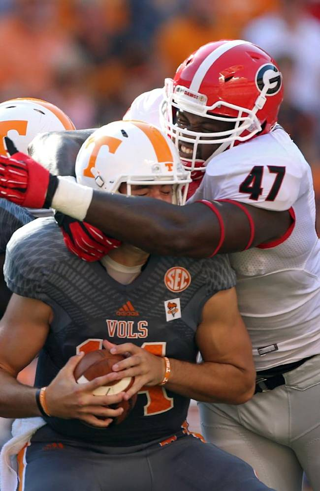 Georgia's Ray Drew (47) sacks Tennessee quarterback Justin Worley (14) during the first half of an NCAA college football game in Knoxville, Tenn., Oct. 5, 2013
