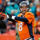 Denver Broncos quarterback Peyton Manning (18) warms up prior to an NFL football game against the Miami Dolphins, Sunday, Nov. 23, 2014, in Denver. (AP Photo/Jack Dempsey)