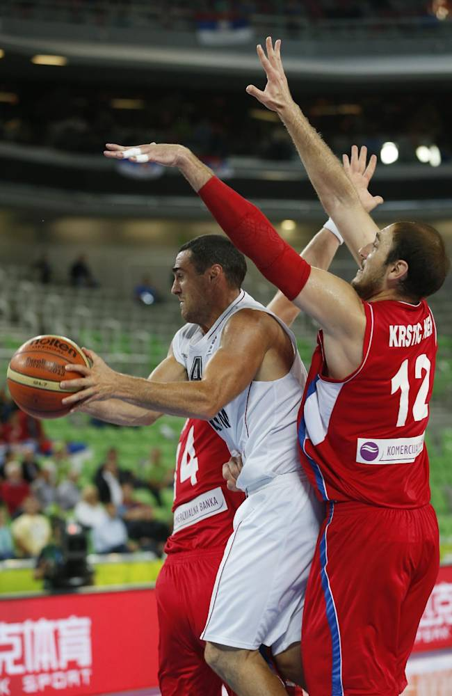 Serbia's Nenad Krstic, right, tries to block Belgium's Roel Moors, left, during their EuroBasket European Basketball Championship Group E match in Ljubljana, Slovenia, Wednesday, Sept. 11, 2013