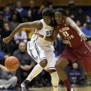 Duke's Elizabeth Williams, left, and Florida State's Natasha Howard (33) chase the loose ball during the first half of an NCAA women's college basketball game in Durham, N.C., Friday, Feb. 22, 2013. (AP Photo/Gerry Broome)