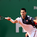 Novak Djokovic of Serbia returns the ball to Roger Federer of Switzerland, during their semifinal match of the Monte Carlo Tennis Masters tournament in Monaco, Saturday, April, 19, 2014. Federer won 7-6, 6-2. (AP Photo/Claude Paris)