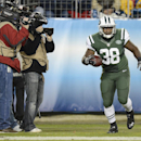New York Jets fullback John Conner (38) scores a touchdown against the Tennessee Titans on a 9-yard pass in the second half of an NFL football game Sunday, Dec. 14, 2014, in Nashville, Tenn The Associated Press