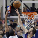 Phoenix Suns center Miles Plumlee (22) denies a basket to Dallas Mavericks forward Brandan Wright (34 during the first half of an NBA basketball game on Saturday, April 12, 2014, in Dallas The Associated Press