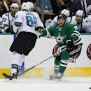 Dallas Stars' Tyler Seguin (91) attempts to get by San Jose Sharks defenseman Brent Burns (88) to a loose puck during the second period of an NHL hockey game, Saturday, Nov. 8, 2014, in Dallas The Associated Press